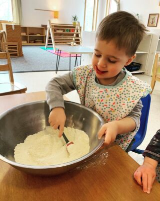 this toddler is stirring ingredients together to bake as our snack. It's fun for the toddlers to be a part of the preparation for their snack, and it's rewarding for them to enjoy eating something that they helped create! 🍽 #montessorimonday #montessori #toddlers #bakery